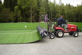 Unroll shockpad artificial grass installation